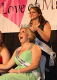 Photo Credit: COURTESY OF THE OREGON DAIRY WOMEN - Emma Miller (front) reacts as she is announced as the 2015 Oregon Dairy Princess-Ambassador by 2014 Princess-Ambassador Danielle Bull on Saturday, Jan. 17. Miller, an Oregon State University student from Independence, won the title over five other young women, including Columbia County Dairy Princess-Ambassador Teri McGettigan.