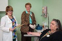 Photo Credit: FILE PHOTO - CVIM Lab Supervisor, Tami Staley, and volunteer, Jean Taylor, discuss lab tests to be performed with patient, Debbie Fredrick.