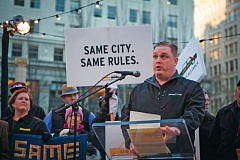Photo Credit: TRIBUNE PHOTO: ADAM WICKHAM - Radio Cab supervisor Noah Ernst calls for Uber to follow the citys for-hire ride rules during a demonstration by Portland cab companies and drivers in Pioneer Courthouse Square.