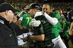 Photo Credit: TRIBUNE FILE PHOTO - Oregon coach Mark Helfrich gets wet after a postseason victory.