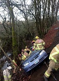 Photo Credit: COURTESY PHOTOS: FOREST GROVE FIRE & RESCUE - Firefighters use heavy extrication equipment to lift an injured teenager out of a car that crashed on Fernhill Road after hitting a patch of ice Jan. 14.