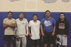 Photo Credit: PHIL HAWKINS - Wrestling is a family affair for these Woodburn brothers: (from left) Woodburn assistant wrestling coach and Woodburn grad Jose Hernandez, his two younger brothers, senior Jesus Hernandez and eighth-grader Marcos Hernandez, assistant coach Eddie Cruz and his brother, senior Jose Martinez.