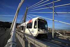 Photo Credit: TRIBUNE PHOTO: JONATHAN HOUSE - For the first time, a TriMet MAX train traveled across the new Tilikum Corssing Wednesday morning under its own power as a test of the bridge's rail and power systems. Trains and buses will use the bridge as part of the new Portland-to-Milwaukie light-rail line.