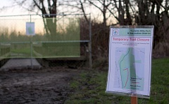 Photo Credit: TIMES PHOTO: MILES VANCE - Dam-building activity by beavers at Greenway Park in Beaverton covered one path in water and forced its temporary closure.