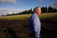 Photo Credit: TIMES PHOTO: JAIME VALDEZ - Jim Daniels who has owned his Sexton Mountain condominium for 8 months, is distraught that the city of Beaverton plans to build solar panels on the grassy area that covers a water tank.