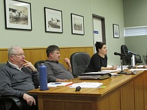 Photo Credit: MARK MILLER - Tiffany Smith (right), interim president of the South Columbia County Chamber of Commerce board of directors, speaks during a chamber board meeting in Scappoose City Hall on Tuesday, Jan. 20. Also pictured: board members Steve Jensen (left) and Blair Walter (center).
