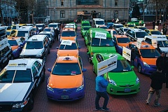 Photo Credit: TRIBUNE FILE PHOTO: ADAM WICKHAM - Dozens of off-duty taxis packed Pioneer Courthouse Square to protest Uber at a Jan. 13 demonstration. A new Uber survey shows that drivers often use the service to supplement existing income.