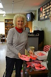 Photo Credit: COURTNEY VAUGHN - Carolyn King adds to a large stack of hand made valentine cards at the Scappoose Senior Center.