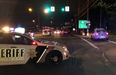 Photo Credit: COURTESY WASHINGTON COUNTY SHERIFF'S DEPT. - Washington County Sheriff's deputies and medical personnel investigate the scene of a fatal accident involving a vehicle and a pedestrian that occurred Thursday evening near Providence St. Vincent Medical Center.