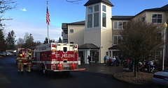 Photo Credit: COURTESY OF CHRIS LAKE - Columbia River Fire & Rescue personnel respond to reports of smoke at Avamere in St. Helens, an assisted living center on Gable Road, that prompted residents to evacuate. Firefighters found that an overheating light fixture ballast was responsible for the odor.