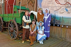 Photo Credit: SUBMITTED PHOTO - Members of the Krayon Kids Elite Travel Troupe get ready for a musical number on the Oregon Trail. Pictured at left, Micheal Meier and sitting, Zak Stevens and Ellie Grenfell; back row, Mason Hegardt and Danielle Hill.