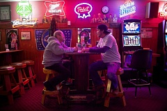 Photo Credit: OUTLOOK PHOTO: TROY WAYRYNEN - Sean Mullins, left, and Christopher Kelly enjoy a beer and conversation at Gresham Inn on Friday, Jan. 23.