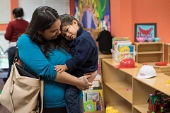 Photo Credit: NEWS-TIMES PHOTOS: CHASE ALLGOOD - CREATE student Christina Martinez and her son, Eric Martinez, 2, participate in the Cornelius programs childcare program.