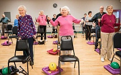 Photo Credit: NEWS-TIMES PHOTO: CHASE ALLGOOD - Instructor Sue Groszmann uses a variety of exercise equipment while leading a group of seniors through a Stretch & Tone class at Fitness 1440 in Forest Grove.