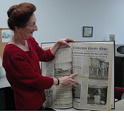 Photo Credit: ESTACADA NEWS PHOTO: ISABEL GAUTSCHI - Local historian Kathryn Hurd beams at a juicy article in the 1989 Estacada News archives. Hurd is planning to explore Estacada's past through entertaining stories and anecdotes that lend insight into the town's history. She is preparing a book on the subject.