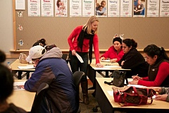 Photo Credit: TIMES PHOTO: JAIME VALDEZ - Madison Kenney, a junior from Lincoln High School, helps adults with forms during a Mission Citizen class at the Tualatin Library.