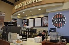 Photo Credit: COURTNEY VAUGHN - Tully's Coffee inside the Fred Meyer store in Scappoose is set to be replaced by a Starbucks Coffee Company stand. Mariah Armijo, picutred, says she looks forward to getting the experience of working at a Starbucks location.