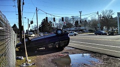 Photo Credit: SUBMITTED PHOTO - A car going eastbound on Powell Blvd struck a pole and rolled over at 10:27 a.m.