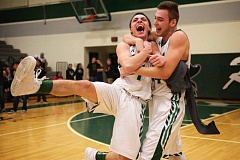 Photo Credit: THE OUTLOOK: TROY WAYRYNEN - Alec Baldridge celebrates with teammate Shendrit Jashari after hitting the winning 3-pointer at the buzzer Friday night.
