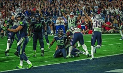 Photo Credit: COURTESY OF MICHAEL WORKMAN - Players on both sides react as Malcolm Butler hits the turf with the game-saving interception in Super Bowl XLIX. The New England Patriots rallied to dethrone the Seattle Seahawks 28-24 Sunday at Glendale, Ariz.