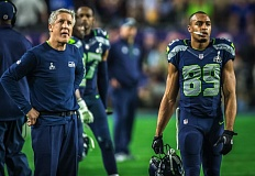 Seattle coach Pete Carroll and receiver Doug Baldwin assess the situation after the Seahawks threw an interception in the closing seconds and came up short in Super Bowl XLIX.