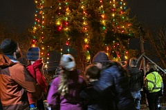 Photo Credit: DAVID F. ASHTON - Neighbors gather to admire the SMILE Christmas tree, overlooking Oaks Bottom - and finally lit on December 16, for the just-past Holiday season.