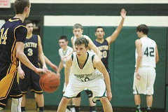 Photo Credit: PHIL HAWKINS - North Marion senior Josh Umbenhower dials in the defense at home against Stayton Jan. 27.