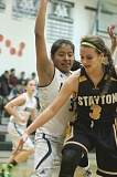 Photo Credit: PHIL HAWKINS - North Marion senior Marivi Rodriguez defends the post against Stayton's Tess Hendricks on Jan. 27.