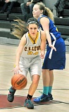 Photo Credit: SETH GORDON - On point - Brittany Trowbridge  dribbles into the lane during C.S. Lewis Academy's 34-15 loss to Portland Waldorf Jan. 29. The Watchmen closed out the week with a 40-15 loss to Falls City Friday night, with Trowbridge scoring a team-high nine points.
