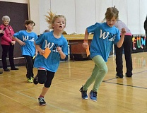 Photo Credit: TIDINGS PHOTO: VERN UYETAKE - First-graders Kylie Rusk and Charlotte Hart turn another lap.