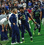 Photo Credit: COURTESY OF MICHAEL WORKMAN - A busy, memorable Super Bowl week in Arizona came down to Seattle QB Russell Wilson and coach Pete Carroll discussing the teams final offensive play (above) moments after the New England Patriots intercepted Wilson  at the 1-yard line, and colorful Seahawks fans and cheerleaders.