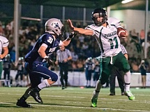 Photo Credit: PAMPLIN MEDIA GROUP: JOSH KULLA - Parkrose High quarterback Jonathan Boland applies a stiff-arm to Wilsonville defensive back Charlie Stapleton. Boland was one of five high school players to sign a letter-of-intent with Portland State last week.