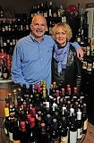 Photo Credit: REVIEW, TIDINGS PHOTO: VERN UYETAKE - Rick Baldwin and Susan Olson get a highly diverse clientele at World Class Wines. They will soon be moving their shop to another location in Lake Oswego.
