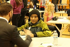 Photo Credit: TIDINGS PHOTO: KATE HOOTS - Eighth-grader Daniel Bernal sits for an employment interview with Josh Jensen during Rosemont Ridge Middle School's annual career day Feb. 4.