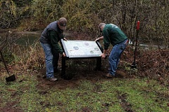 Photo Credit: CONTRIBUTED - Clackamas County Park Rangers Thomas Gray, left, and Victor Harshman install  a new interpretive sign at Eagle Fern Park on Wednesday, Feb. 4