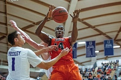 Photo Credit: COURTESY OF JOHN LARIVIERE - Daniel Gomis of Oregon State collects a rebound in a game this season at the University of Portland.