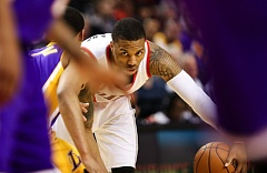 Photo Credit: COURTESY OF DAVID BLAIR - Damian Lillard surveys the Los Angeles Lakers' defense in the Trail Blazers' homecourt victory Wednesday night.
