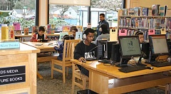 Photo Credit: OUTLOOK PHOTO: JODI WEINBERGER - Study areas are filled after school at the Rockwood Library.
