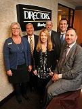 Photo Credit: STAFF PHOTO: VERN UYETAKE  - Pictured from left, front row, are Directors Mortgage team members Stacy Poushey and Sherry Grubb and President and CEO Mark Hanna. Second row from left are Greg Pool, Jim Abreu and Kevin Hanna.