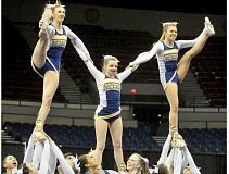 Photo Credit: SETH GORDON - Three on top - The Newberg cheerleading team performs a near-flawless routine to earn its third consecutive 6A state title Saturday at the Memorial Coliseum in Portland.