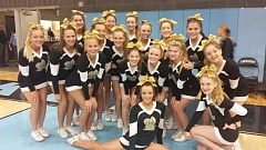 Photo Credit: SUBMITTED PHOTO - West Linn High School's cheer team competes at the OSAA state championships, earning a spot in the top three and an invitation to compete at Nationals in March.