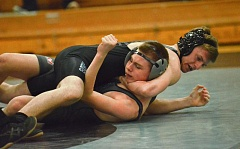 Photo Credit: VERN UYETAKE - The Pacers' Jeric Mauro pinned his opponent at 132 pounds in the first round.