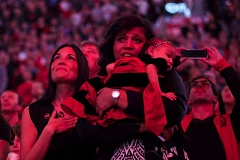 Photo Credit: TRIBUNE PHOTO: JAIME VALDEZ - Teri Kersey, wife of the late Jerome Kersey, and his daughter, Kiara, who is holding her daughter, Harley, watch the big screen at Moda Center on Sunday night as the Trail Blazers pay honor to the late forward with a video of him singing the national anthem when he was a player for Portland.
