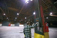 Photo Credit: TRIBUNE PHOTO: JONATHAN HOUSE - Bureau of Environmental Services property manager Eli Callison turns on the lights in bureau-owned warehouse that sits at Terminal 1 in Northwest Portland. The bureau is hoping to sell the 18-acre industrial site