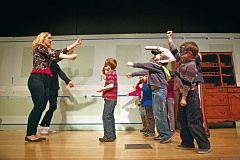 Photo Credit: TIMES PHOTO: JAIME VALDEZ - Heidi Davis, a camp teacher with the Experience Theatre Project, demonstrates some acting exercises to children at the Beaverton Civic Theatre.