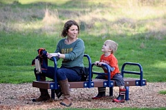 Holly Polivka, a member of the city's Parks and Recreation Advisory Board, and her 3½-year-old son Coby enjoy the equipment at Dirksen Nature Park.
