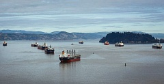 Photo Credit: COURTESY: JOSHUA BESSEX/THE DAILY ASTORIAN - Ships waiting to be unloaded have backup up in the Columbia River because of the long running labor-management dispute at the Port of Portland.