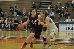 Photo Credit: SETH GORDON - Lake Oswego's Gabby Bruno drives in last week's game at Newberg. The Lakers led at the end of three quarter but came up short on the road.