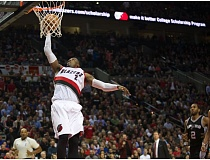 Photo Credit: TRIBUNE PHOTO: JAIME VALDEZ - Wesley Matthews scores on a breakaway dunk as the Trail Blazers defeat the San Antonio Spurs on Wednesday night at Moda Center.