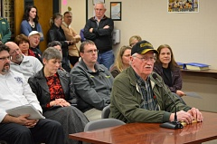 Photo Credit: MARK MILLER - Bert Mueller, a retired football coach at St. Helens High School, speaks in support of replacing the grass field at Ackerson Stadium with artificial turf at a school board meeting Wednesday, Feb. 25.